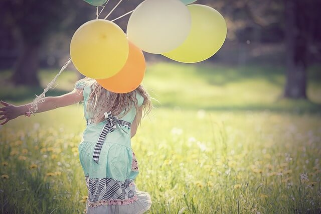 female child holding a balloon